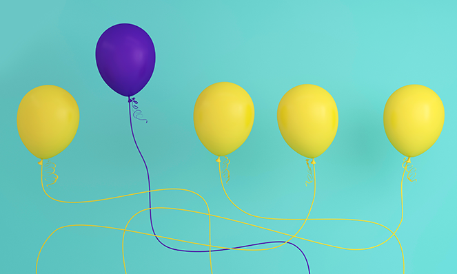 Purple balloon standing out against yellow balloons (branding metaphor)